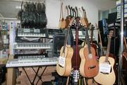 Магазин музыкальных инструментов Мелодия